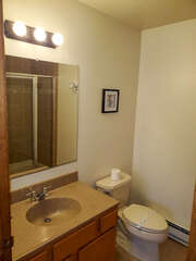 Smaller bathroom with mirror and wall decor