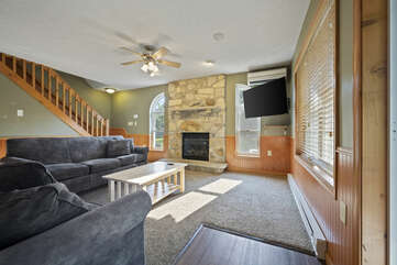 View of Seating Area in Game Room with Fireplace and TV