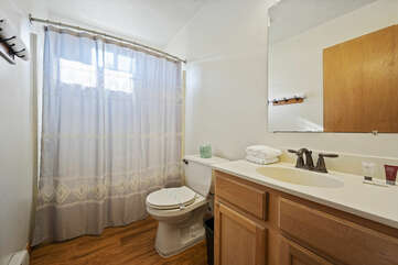 Bathroom area with sink.