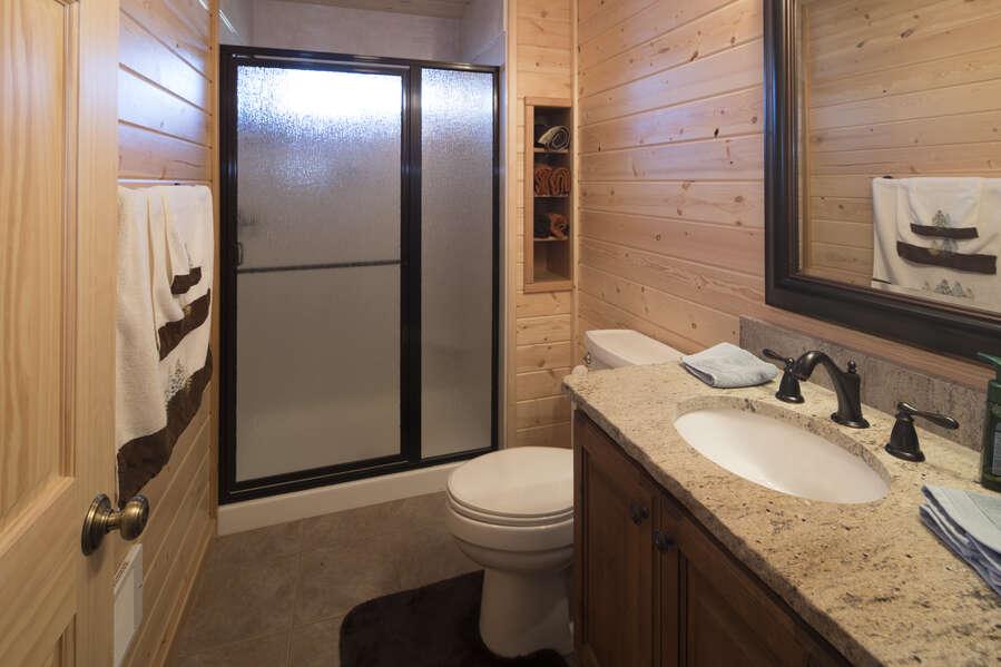 Duck Duck Goose ~ master bedroom on main level w/ queen bed and private ensuite bathroom