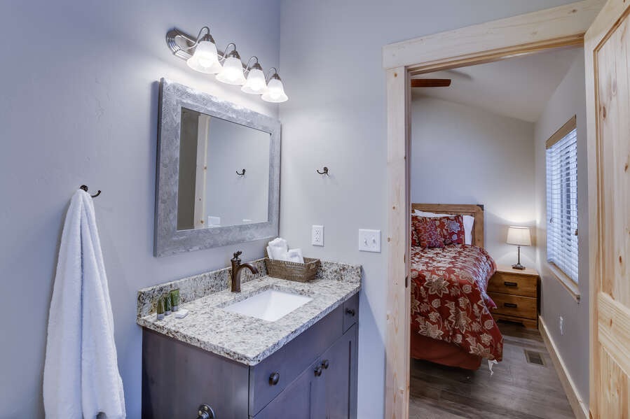 Buck Buck Moose ~ bedroom #2 on main level w/ queen bed and private ensuite bathroom