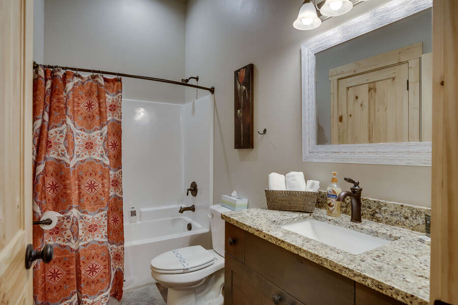 Buck Buck Moose ~ shared bathroom on main level w/ private entrance to bedroom #3