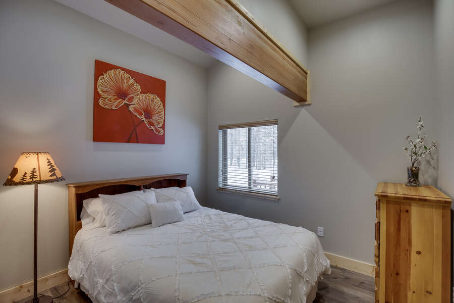 Buck Buck Moose ~ bedroom #3 on main level w/ queen bed and entrance to shared bathroom