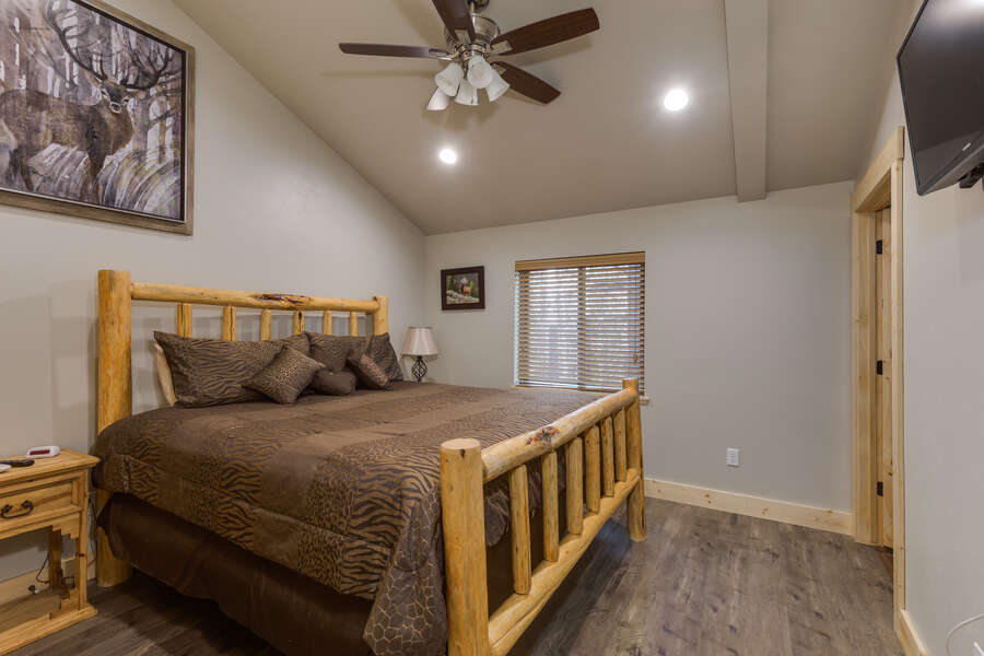 Buck Buck Moose ~ master bedroom on main level w/ king bed and private ensuite bathroom