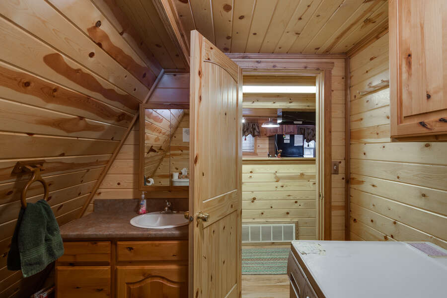 Roger Dodger ~ shared half bathroom in main house on main level (shared with laundry room space)