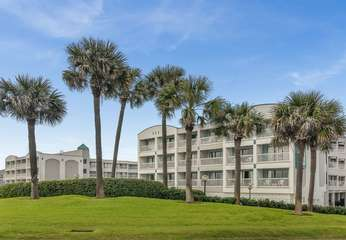 Your condo is in the building on the left surrounded by lush tropical landscape and facing the beach. You can't beat the front row ocean view!!
