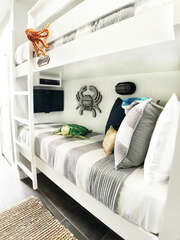 Custom bunk beds with FREE Netflix and Blu-ray player on bottom bunk!! Bunks have been widened, but are still more narrow than a twin.