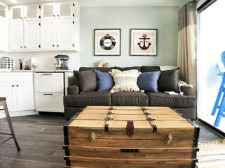 Queen sleeper sofa is shown with memory foam topper! Quilt, sheets and pillows are located in the trunk!