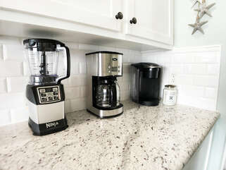 Ninja Blender, Coffee maker AND a Keurig!! Plus tons of fun glasses in the cabinet & extra fridge in the bottom cabinet!