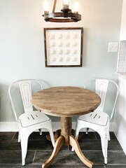Seating for 2 at the table, as well as 2 barstools located at the end of the counter!