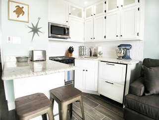 Fully stocked kitchen with stove, microwave, drawer fridge/ freezer that makes ice and TONS of gadgets you'll need & more to make your stay amazing!