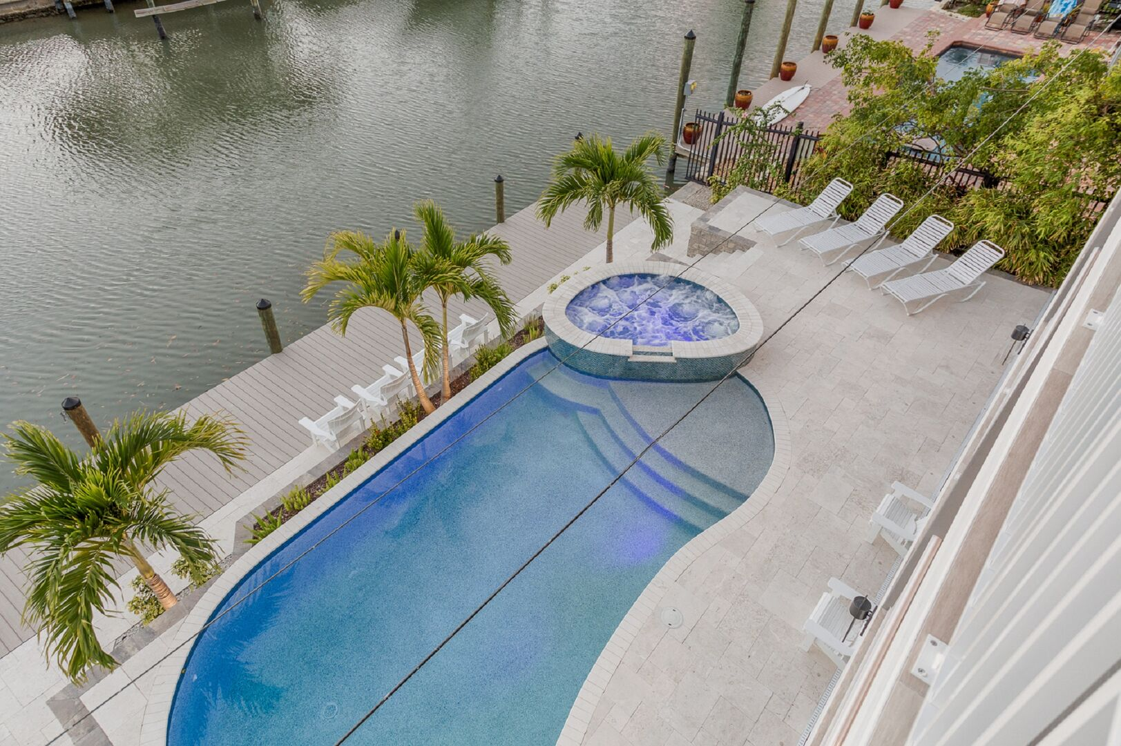 The pool and hot tub of this vacation house for rent in Fort Myers FL.