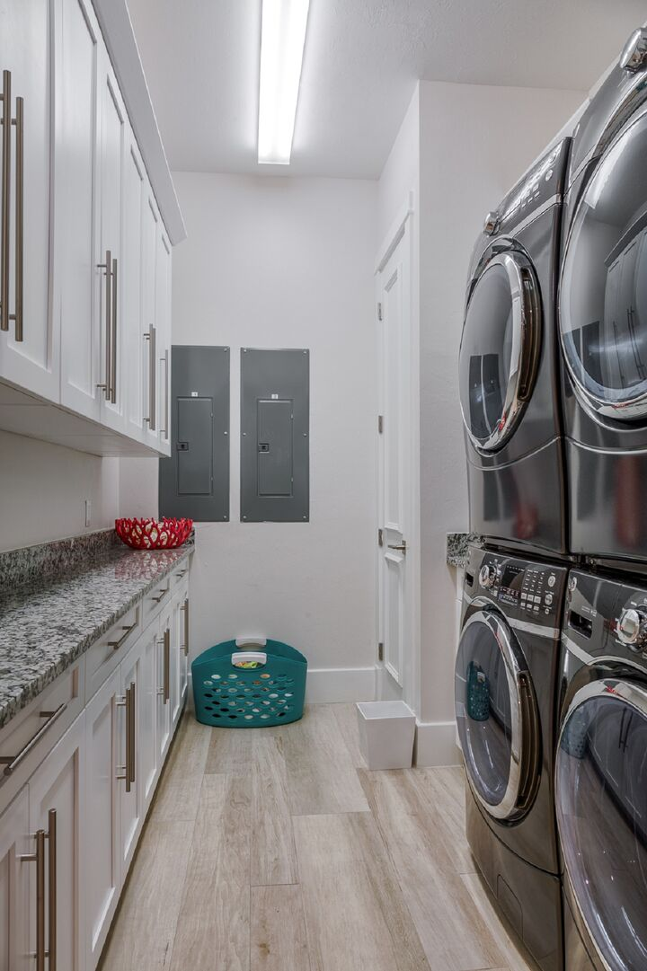 The laundry room with two sets of washers and dryers.