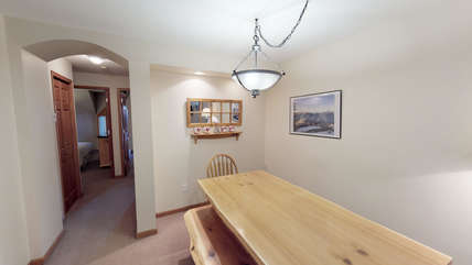 Dining area with hallway leading to the bedrooms