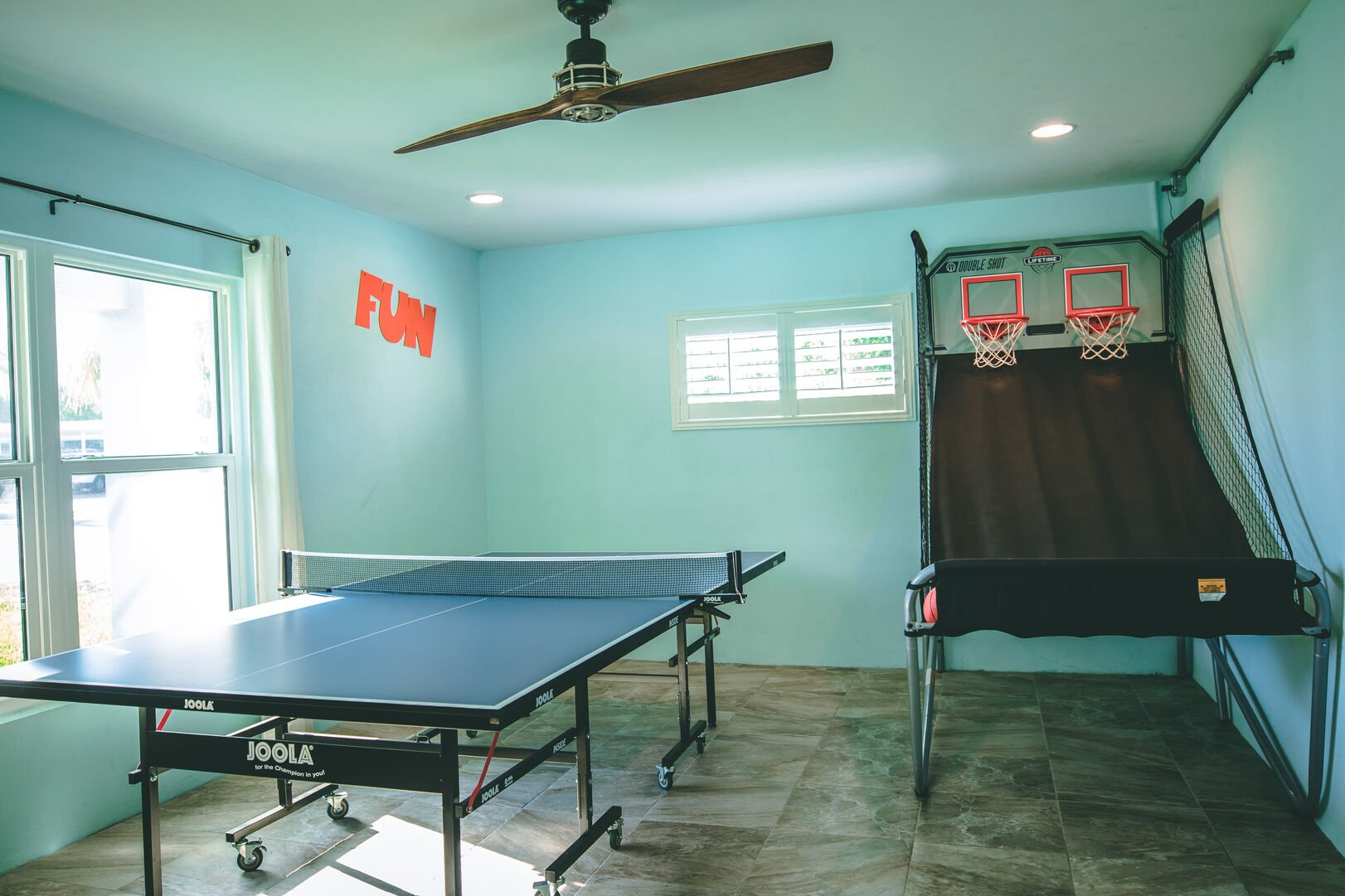 Game room with ping pong table and more