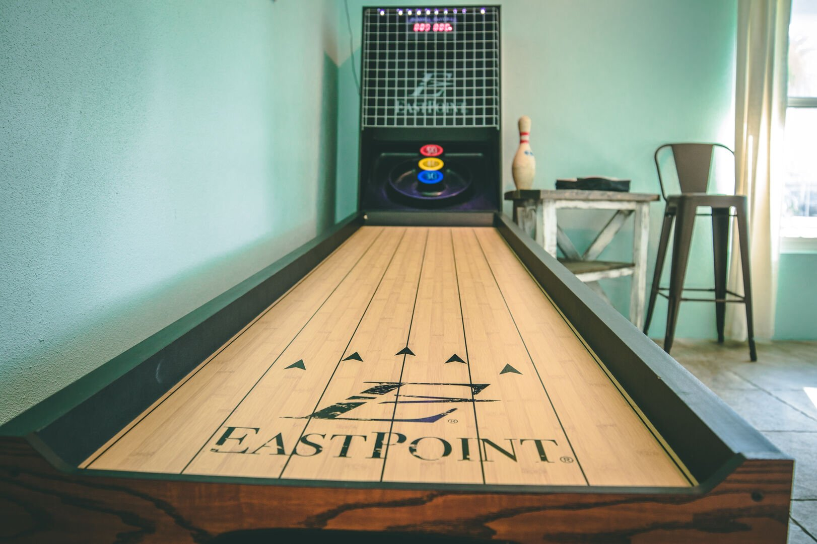 Shuffleboard table in game room