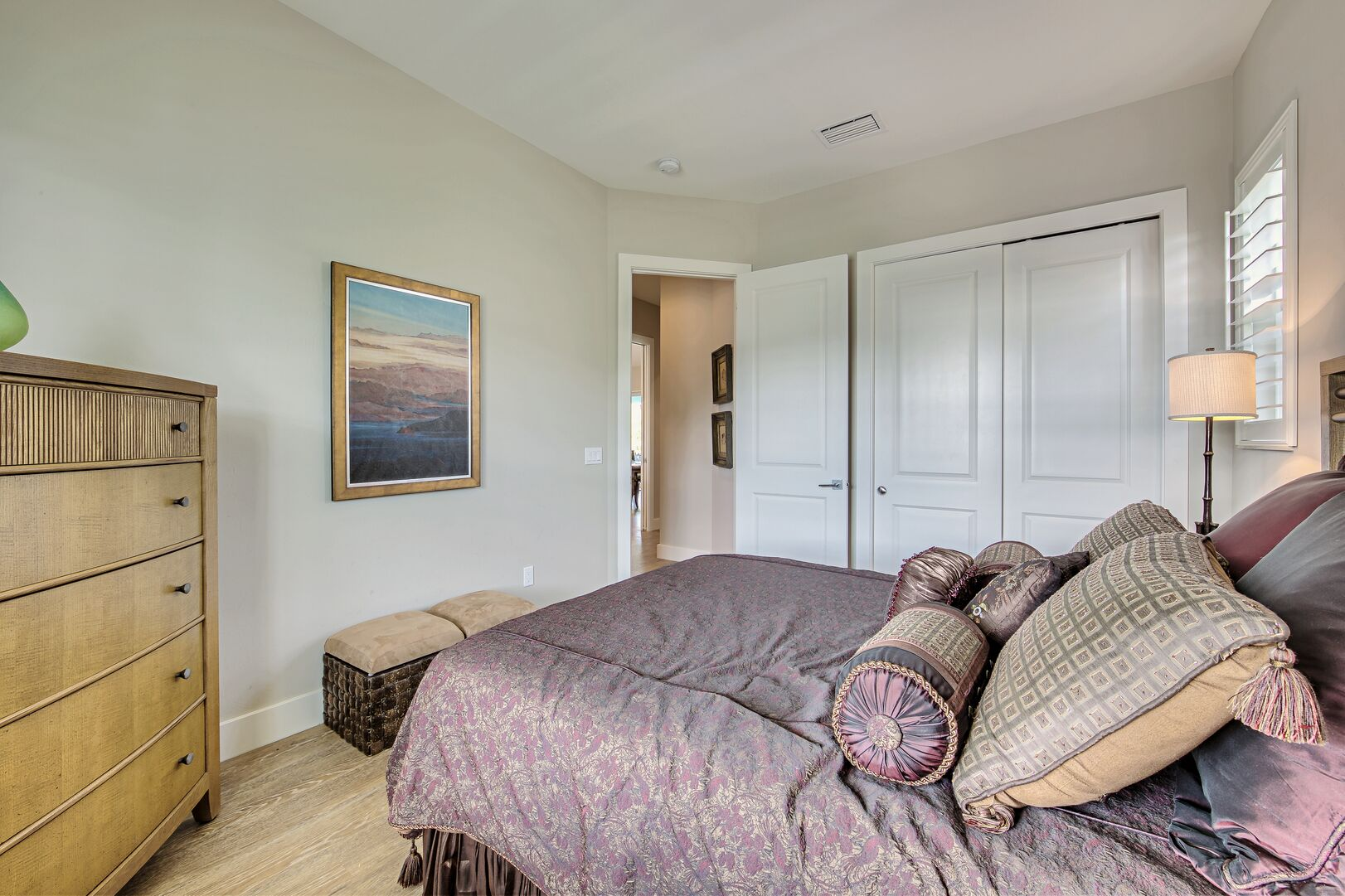 Bedroom with nearby closet
