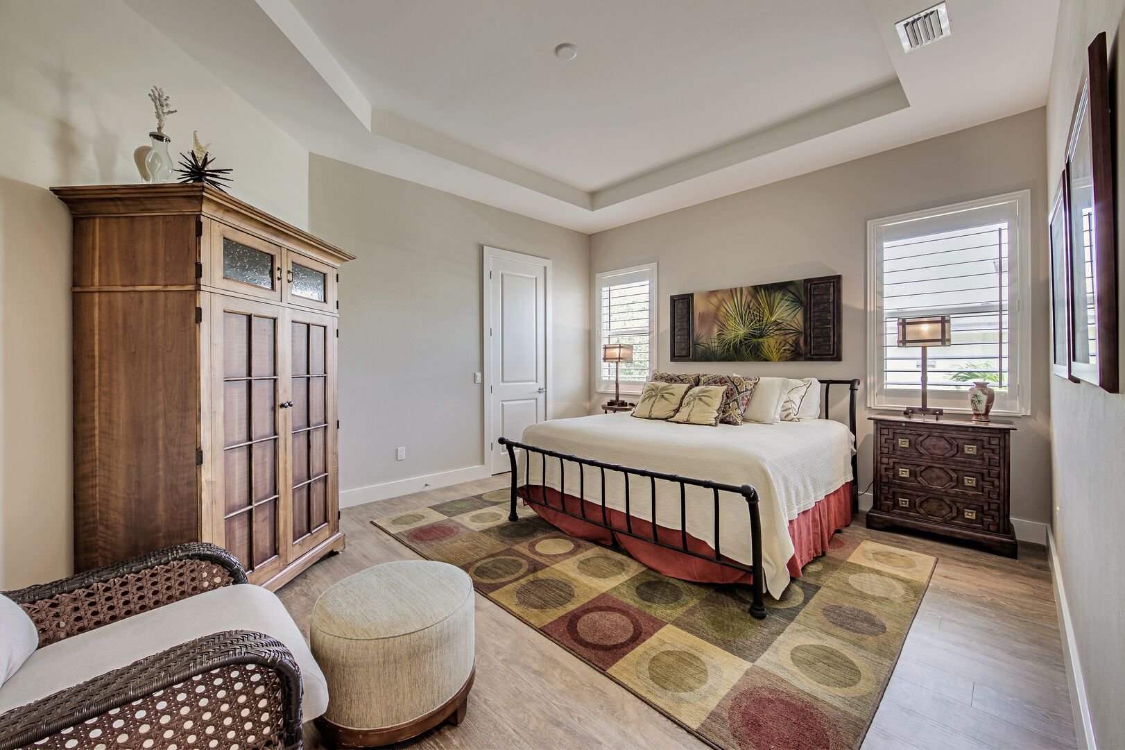 Bedroom area with nearby dresser