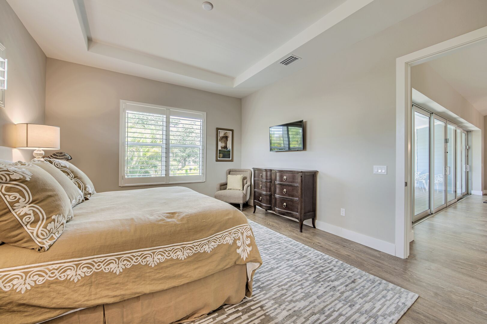 Bedroom with window and wall mounted tv