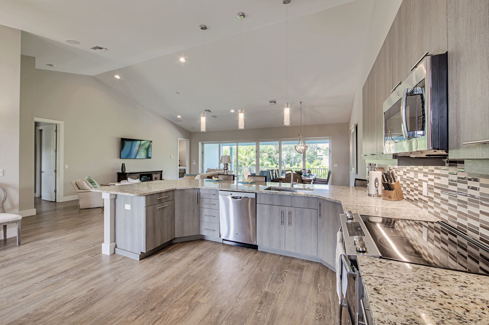 Kitchen area with island, oven and microwave