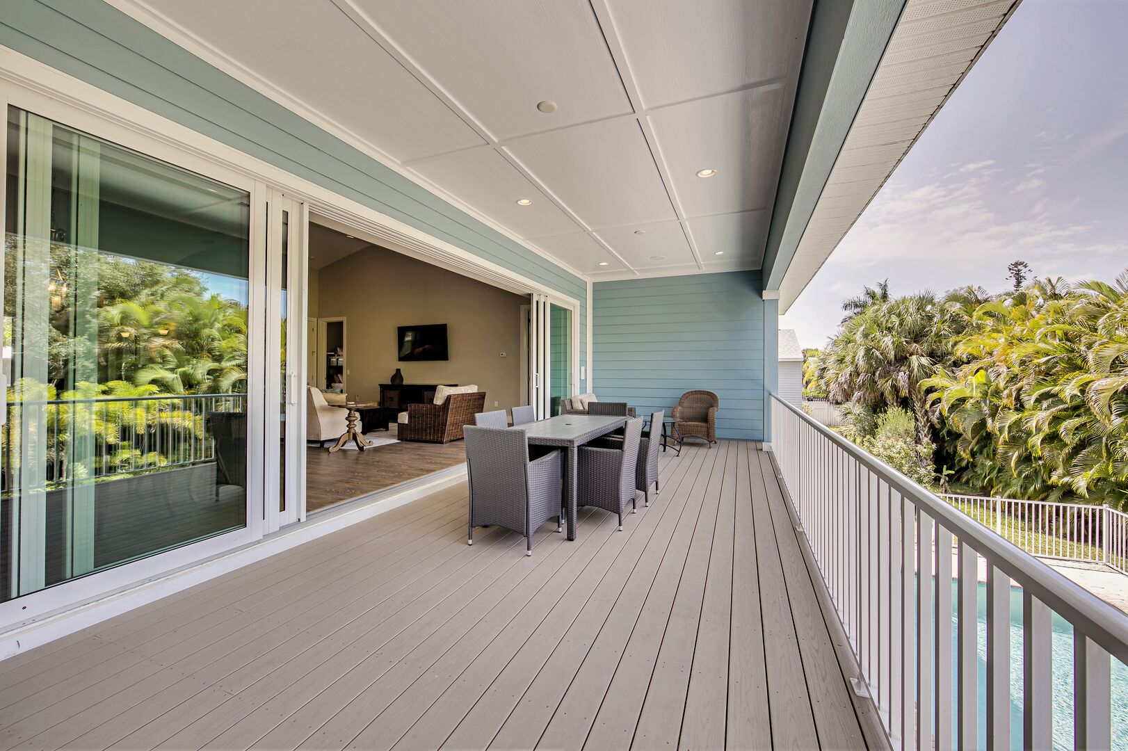 Outdoor seating for six at this vacation rental near Fort Myers Beach