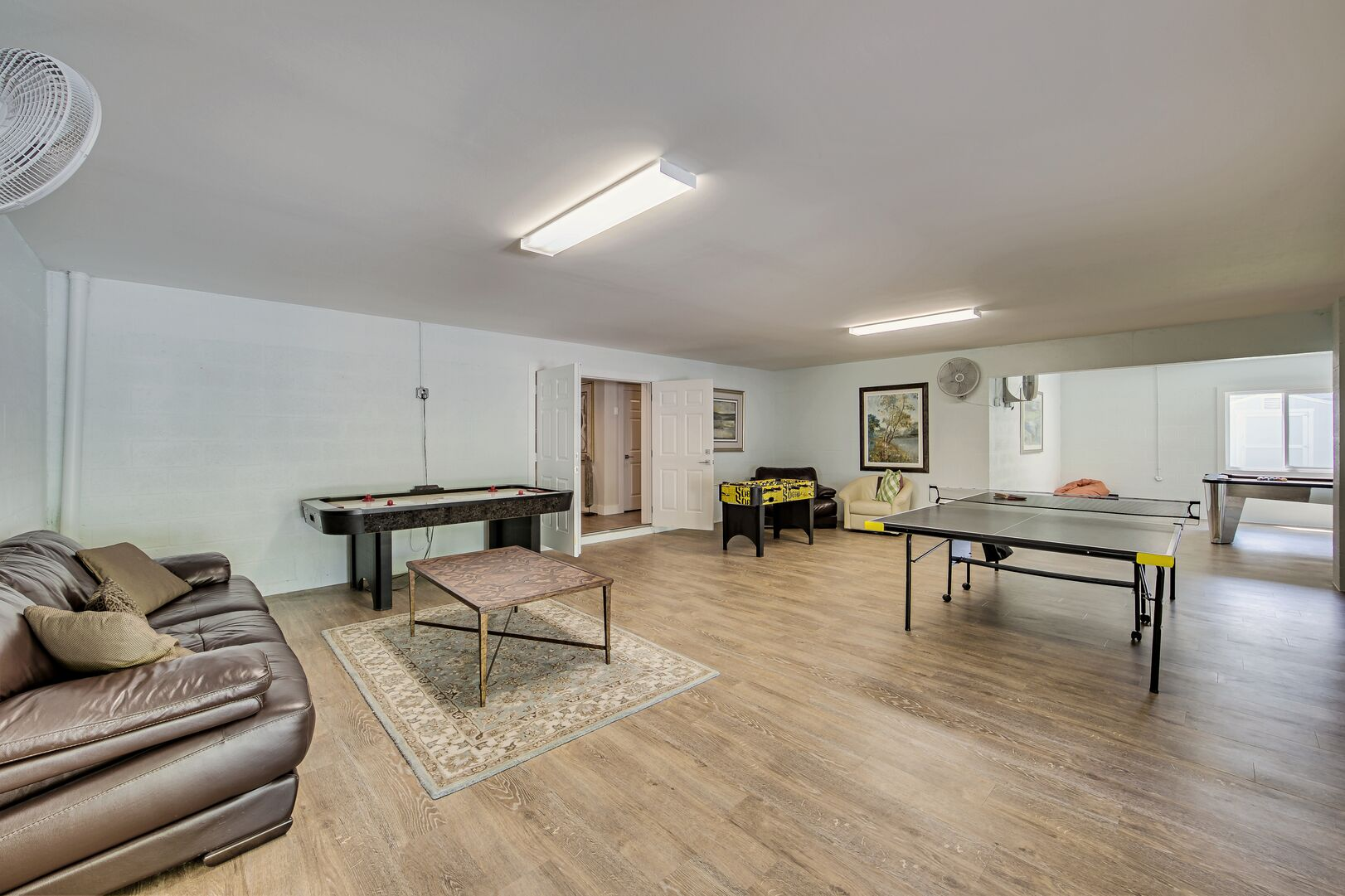 Game room with shuffleboard and ping pong