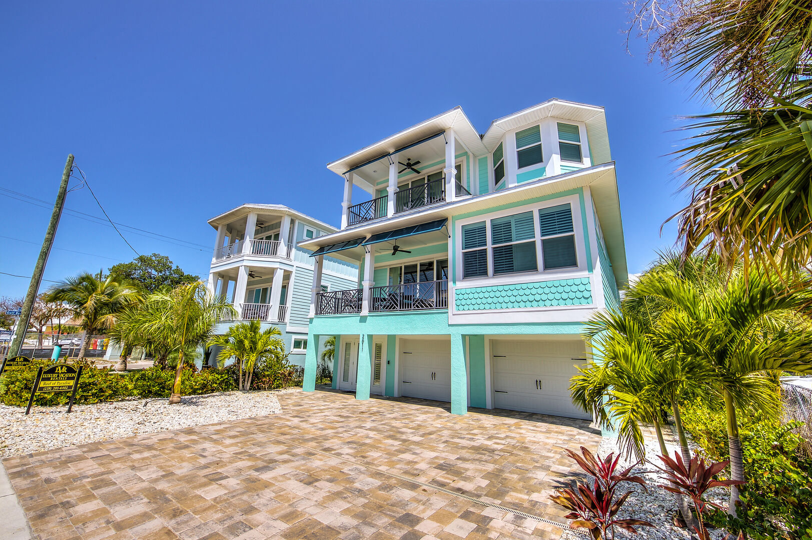 Front exterior and driveway of this Fort Myers Beach rental.