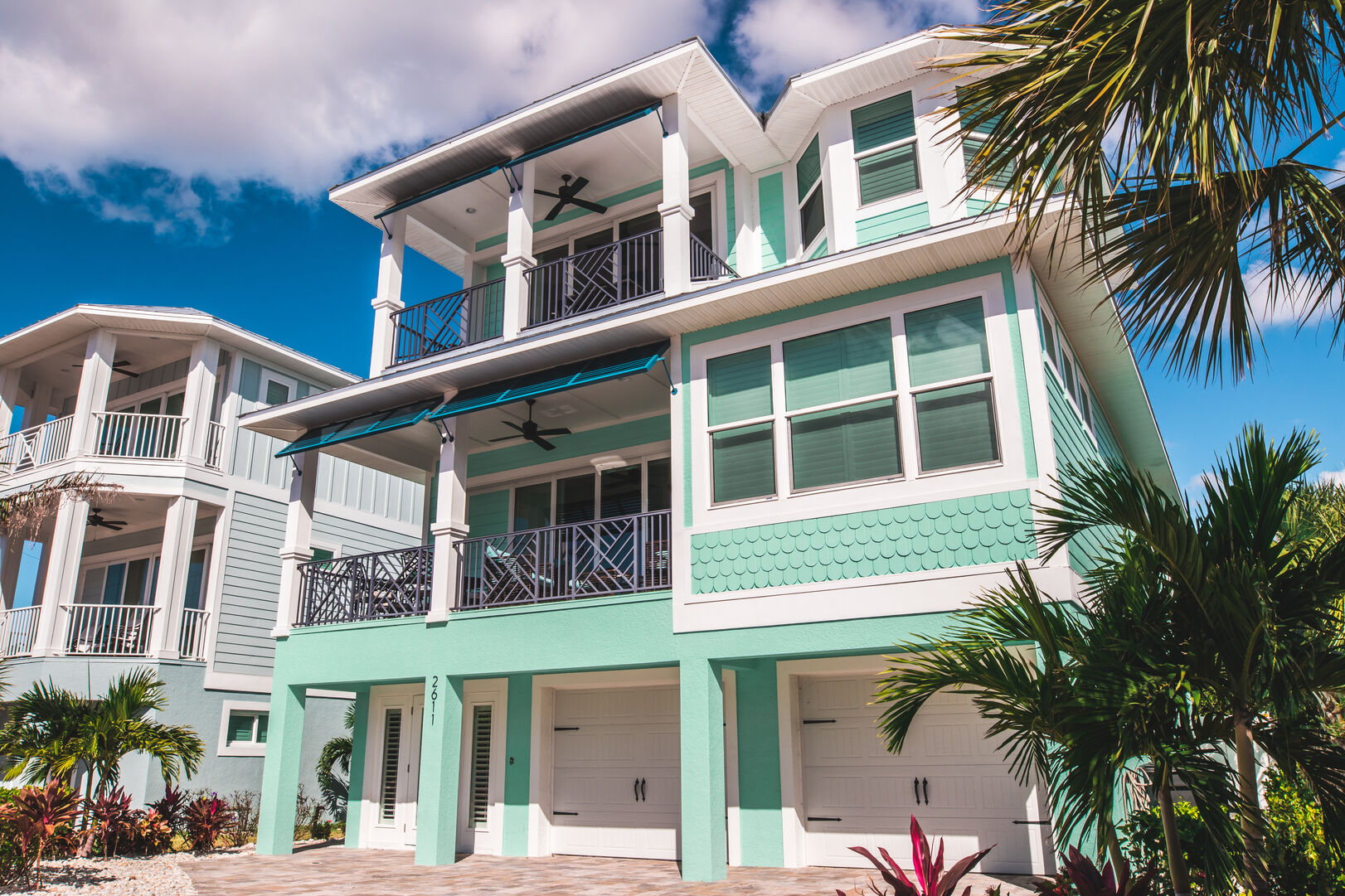 The exterior of this Fort Myers Beach rental, complete with two patios and two garages.