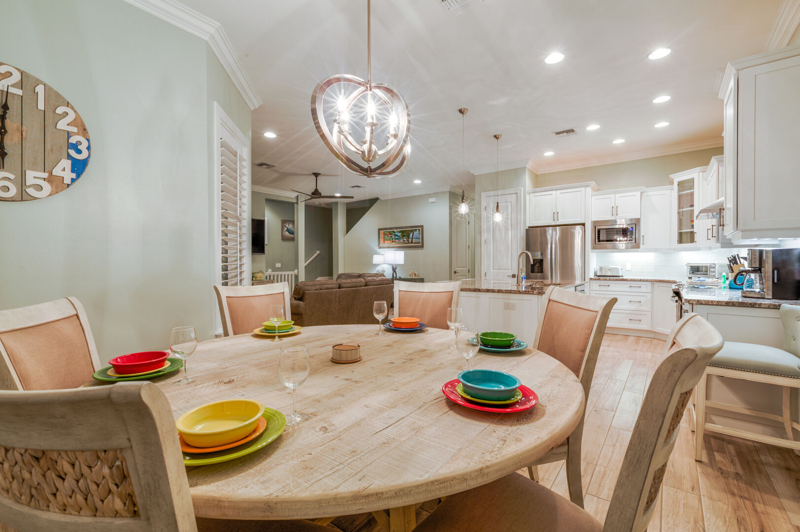 Dining area with a large round table, ample seating, and close proximity to the kitchen.