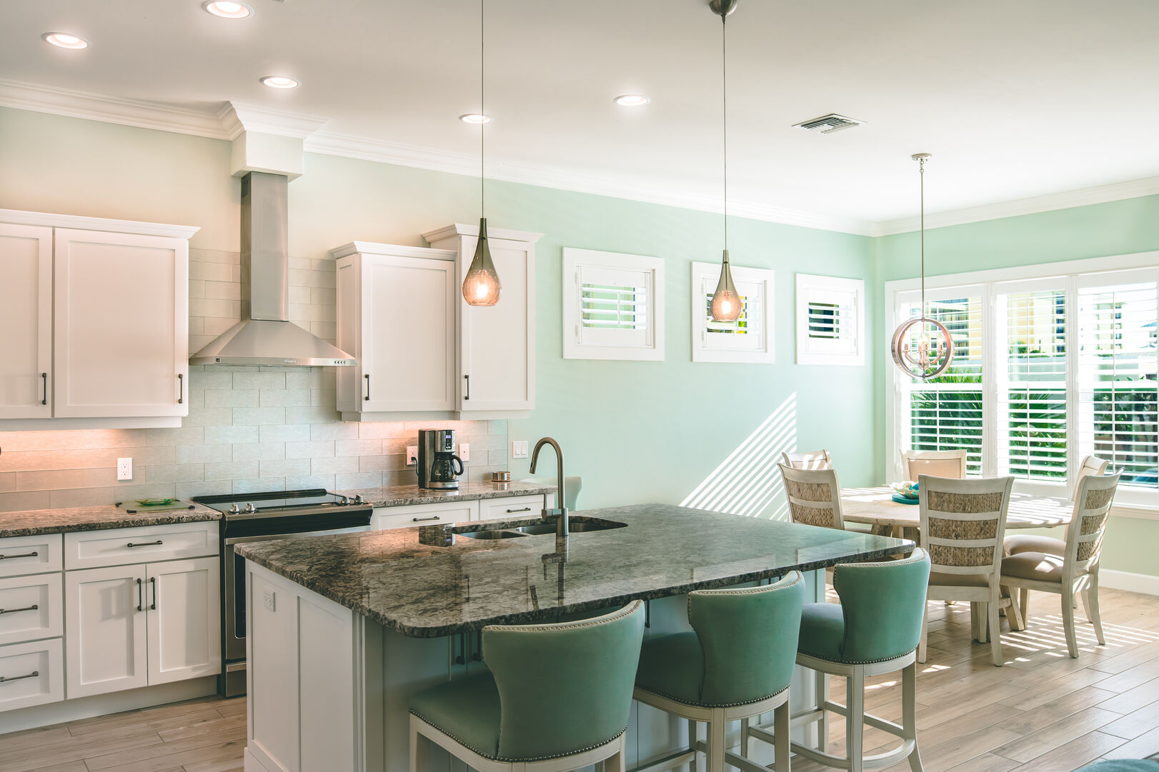 Picture of the kitchen island and dining room.