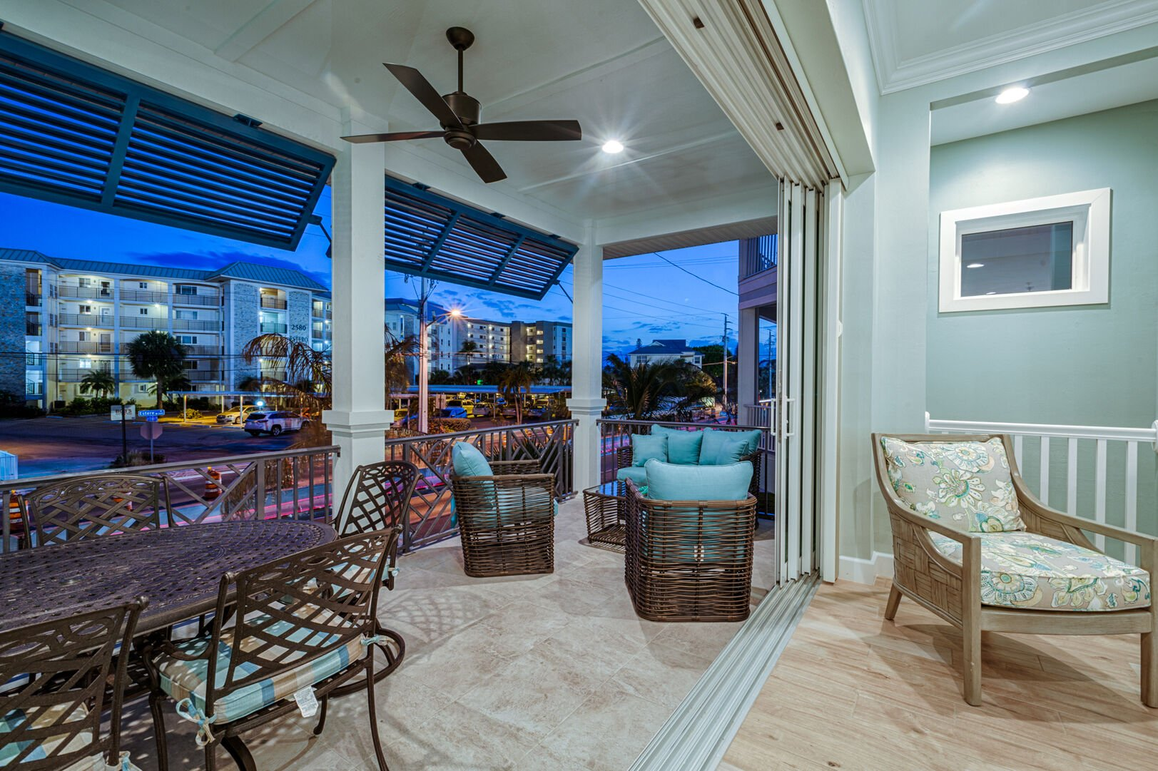 Back patio of this Fort Myers Beach rental, with porch furniture.