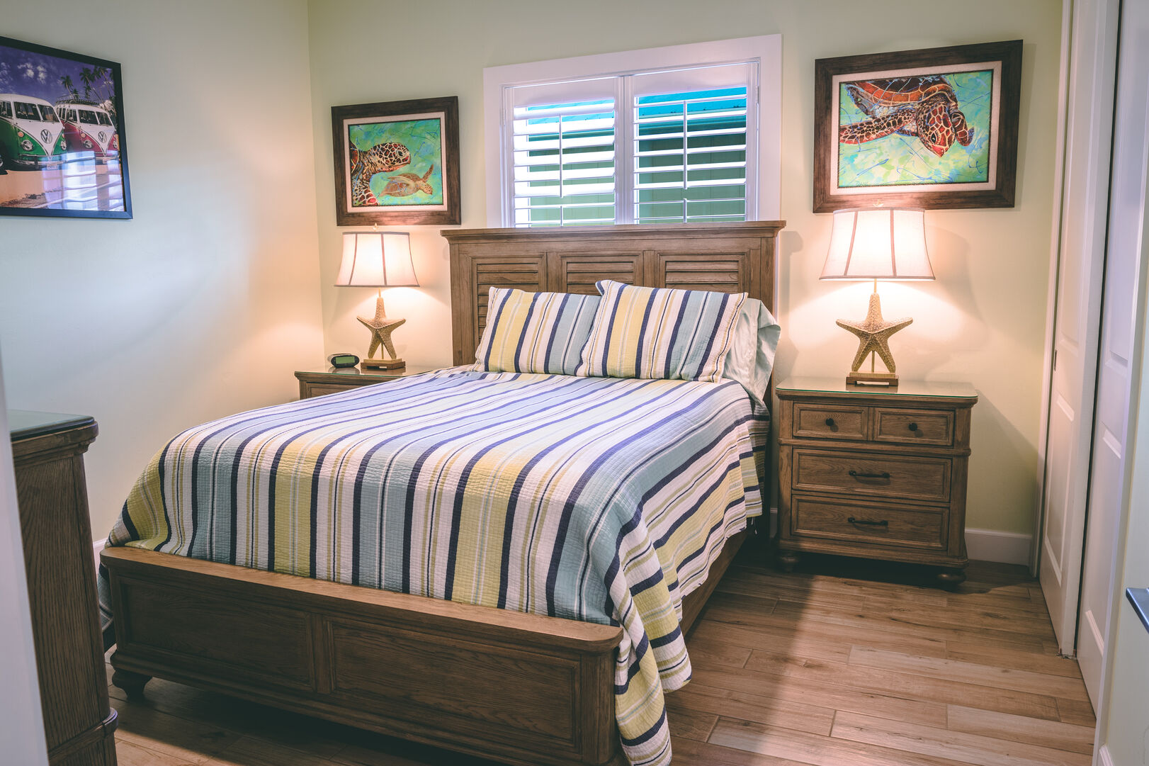 Bedroom with large bed and two nightstands, one on either side.