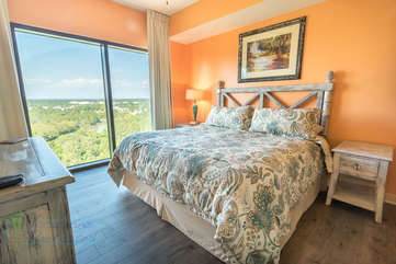 Bright and vibrant master bedroom with king size bed