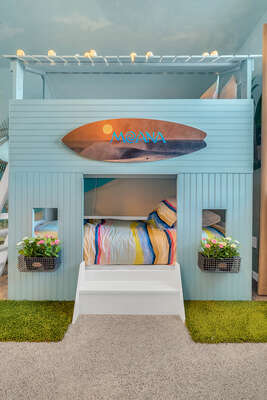 Your own tiki hut doubles as a bunk bed