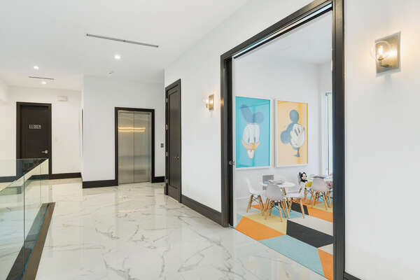 A peek into the play room designed just for kids and of the commercial elevator