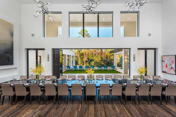 Retractable glass walls bring the outside in and the inside out revealing the lush grounds