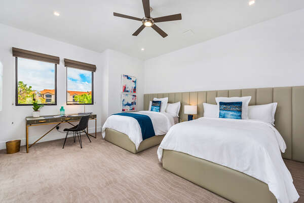 A suite with two double beds, featuring custom mattresses and luxurious finishes