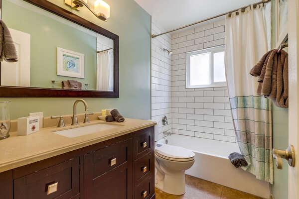 Bathroom with hallway access, tub/shower combo