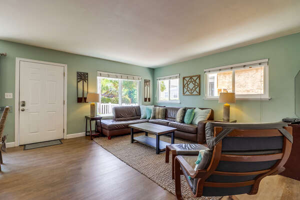 Bright, open floor plan with couch and chair
