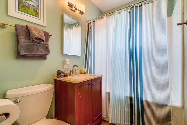 Bathroom with Hallway access, shower/tub combo