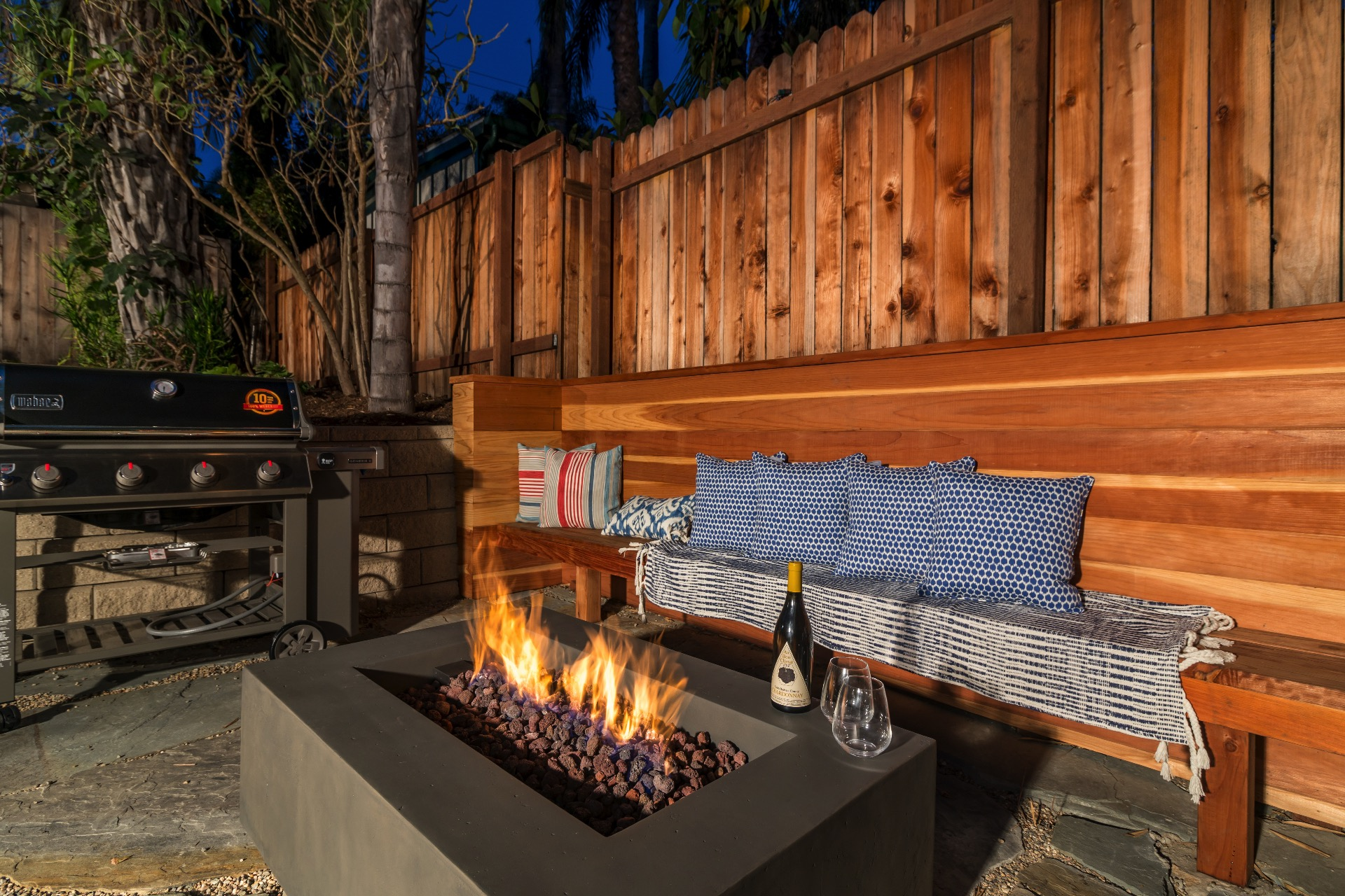 Enjoy a glass of your favorite wine next to the fire table.