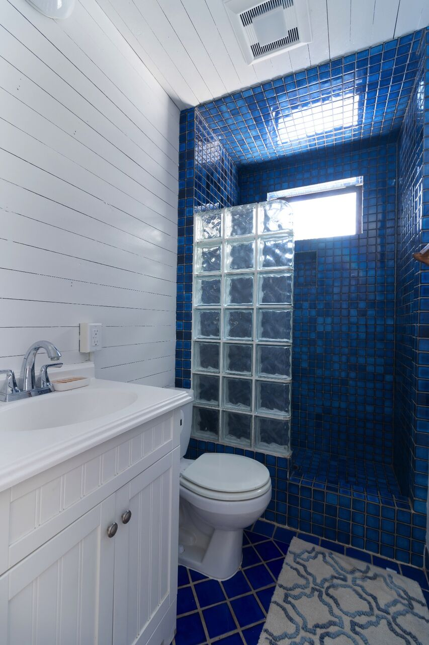 Second bathroom with a walk in shower.