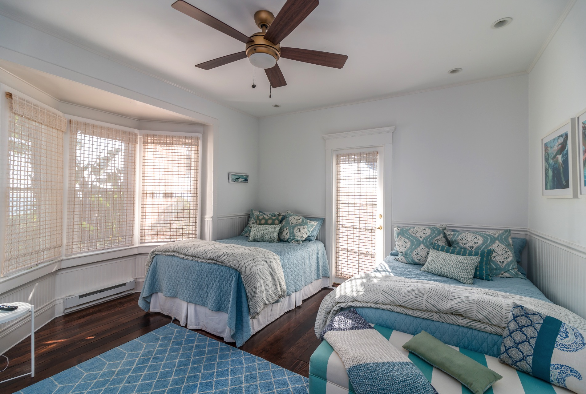 Two full beds, ceiling fan and door out to the side patio.