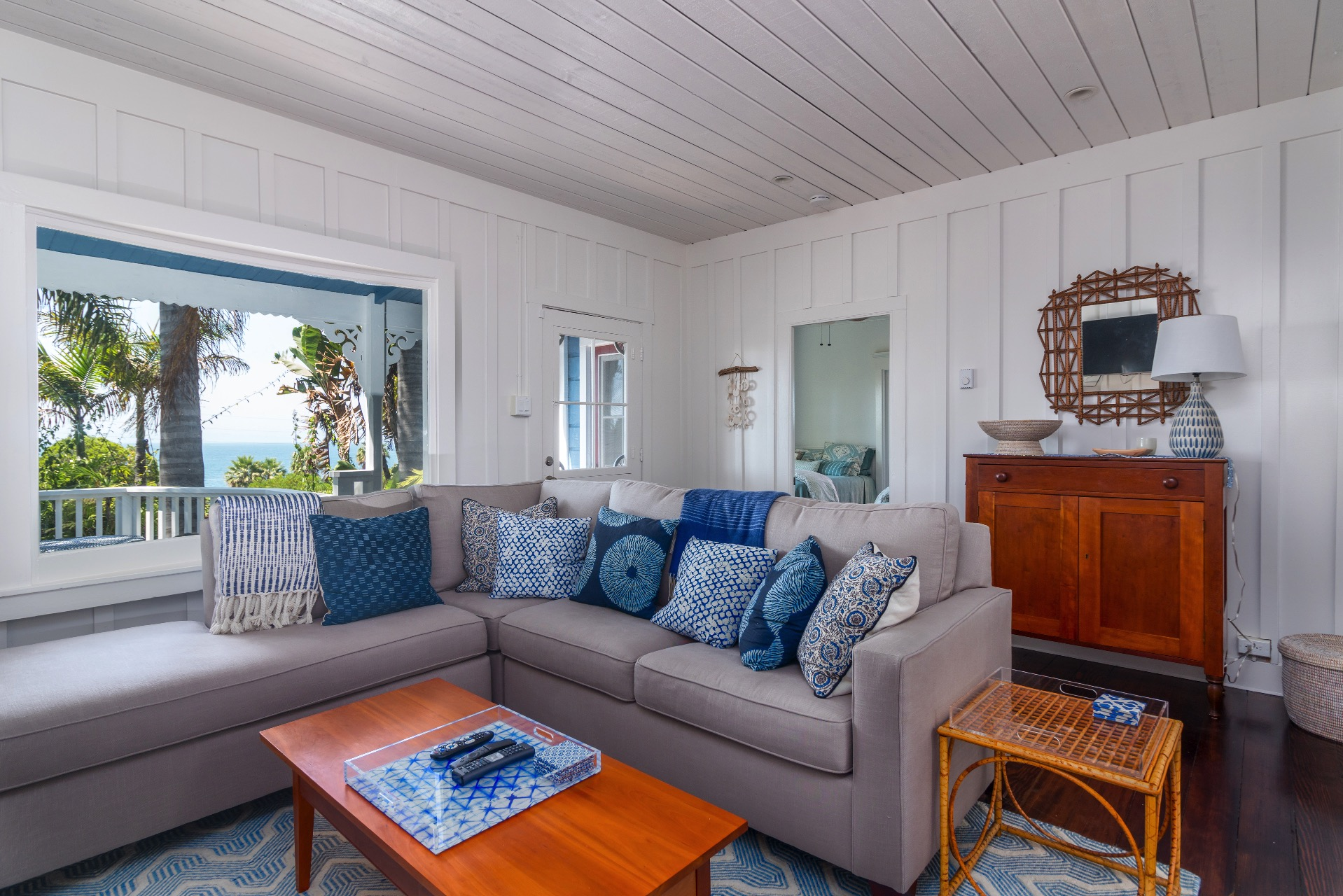 Cozy Living room with large window view of the ocean