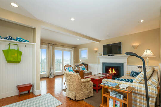 Living room with ample seating with sliders to the deck-325 Main Street Chatham Cape Cod - New England Vacation Rentals
