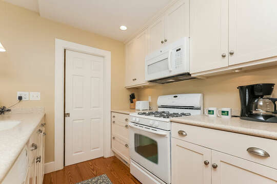Well equipped kitchen , entrance to bath and laundry room325 Main Street Chatham Cape Cod - New England Vacation Rentals
