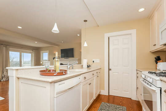 Open concept kitchen , sink, dishwasher, stove- 325 Main Street Chatham Cape Cod - New England Vacation Rentals