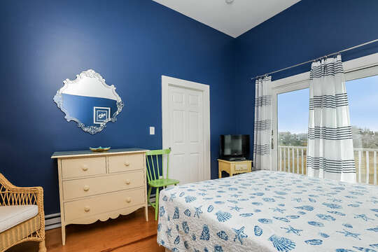 Bedroom #1 second floor Queen bed, tv with slider to upper deck-325 Main Street Chatham Cape Cod - New England Vacation Rentals