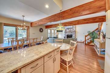 Kitchen Counter, Breakfast and Dining Tables, Chairs, and a View of the Living Area.