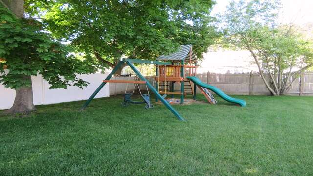 The swing set sits in the shade of the maple trees, perfect for the kids! - 25 Grey Neck Road West Harwich Cape Cod - New England Vacation Rentals